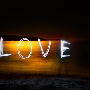 written with light the word Love